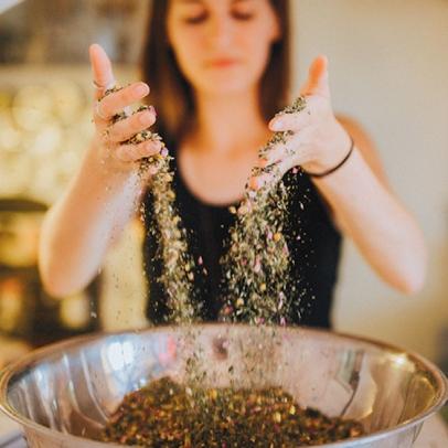 mixing herbal tea blend