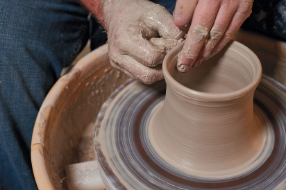 Lance Thompson of Simply Tangled Ceramics in Columbus throwing clay.