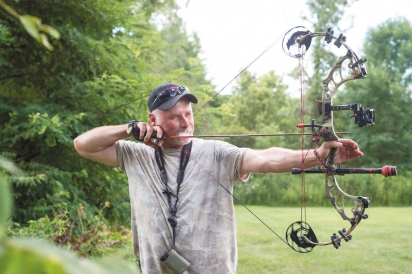 Local deer hunter Rich Malisiak practicing at the archery range in Delaware