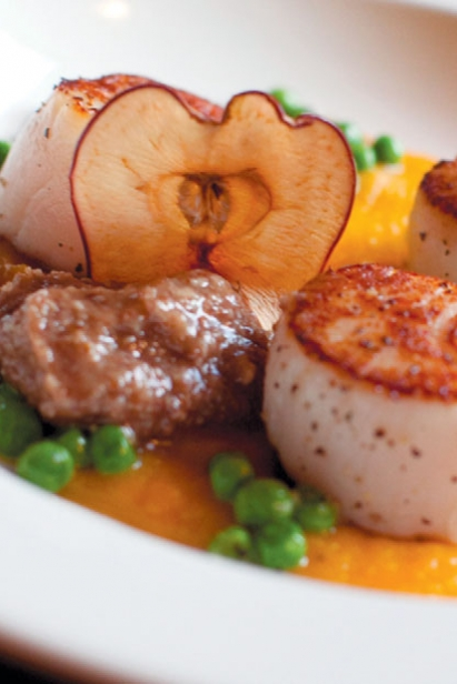 Pan Seared Scallops with Butternut Purée, Sweet Peas, Pecan Butter with an Apple Chip at Kindred Spirits restaurant at The Inn & Spa.