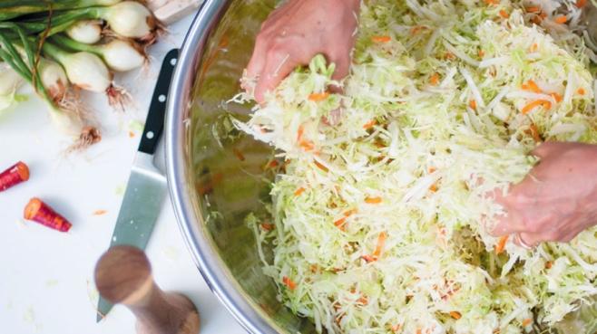 mixing sauerkraut ingredients